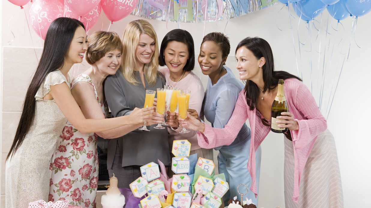 Women toasting drinks at a Baby Shower